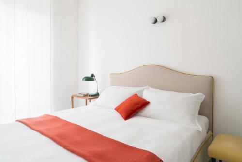 Cama ou camas em um quarto em Brera Apartments