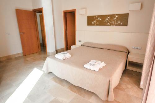 Кровать или кровати в номере Sun Bay Villas