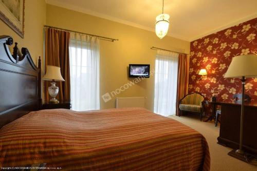 Łóżko lub łóżka w pokoju w obiekcie Gościniec Arkadia