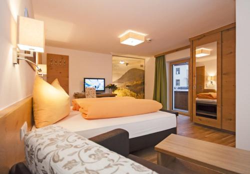 Ein Bett oder Betten in einem Zimmer der Unterkunft Gasthof Venetrast