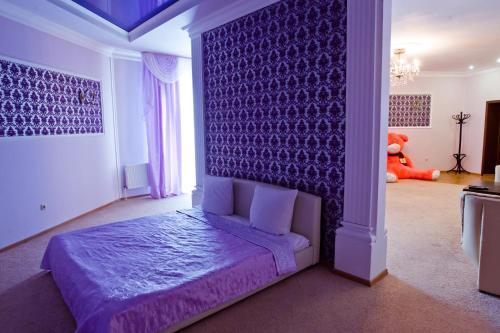 Кровать или кровати в номере Гостиница Сайран