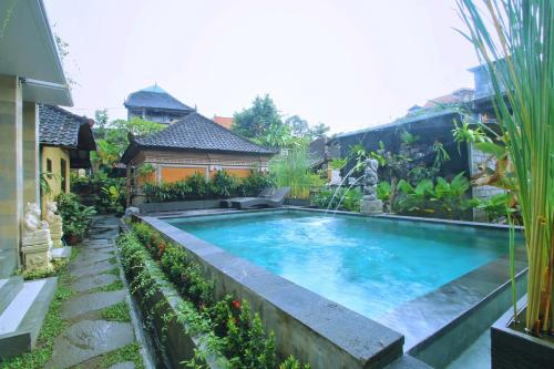 The swimming pool at or near Dewi Putri House