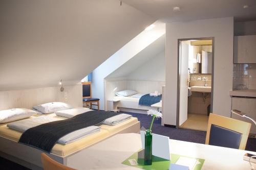 Ein Bett oder Betten in einem Zimmer der Unterkunft Pension Vicus