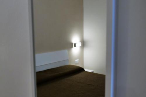Letto o letti in una camera di B&B Il Campanile