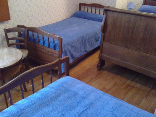Un ou plusieurs lits dans un hébergement de l'établissement Le Commerce