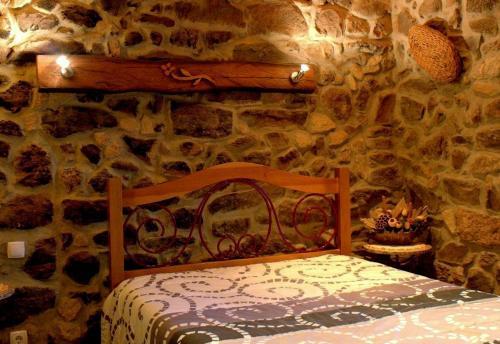 A bed or beds in a room at Casa Da Cidadela