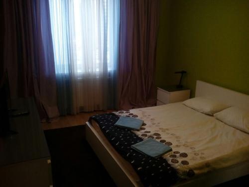 Кровать или кровати в номере Подмосковный бульвар 12