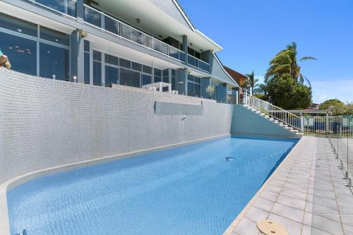 The swimming pool at or near Havana Blue - Large 4 Bedroom Family Home