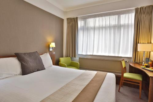 A bed or beds in a room at Best Western Manchester Altrincham Cresta Court Hotel