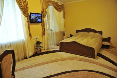 A bed or beds in a room at Andinna Hotel