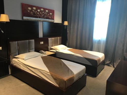 Кровать или кровати в номере Отель Форест