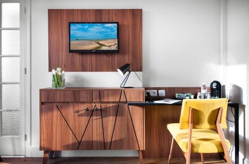 Télévision ou salle de divertissement dans l'établissement Hôtel Métropole centre ville