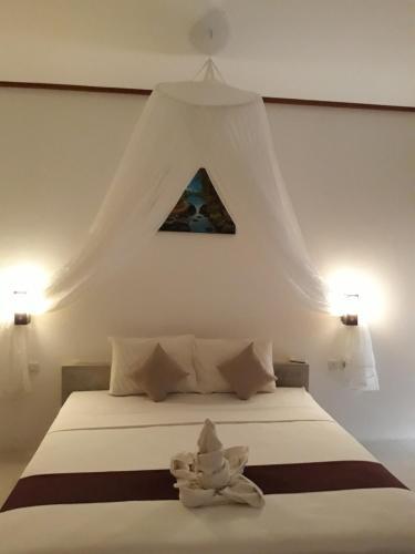 Ein Bett oder Betten in einem Zimmer der Unterkunft Sammy Homestay