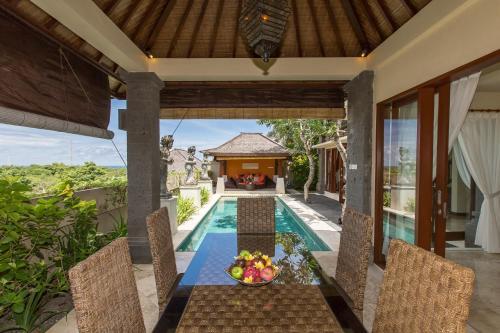The swimming pool at or near Villa Lidwina by Nagisa Bali