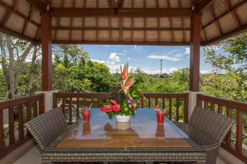 A restaurant or other place to eat at Villa Lidwina by Nagisa Bali