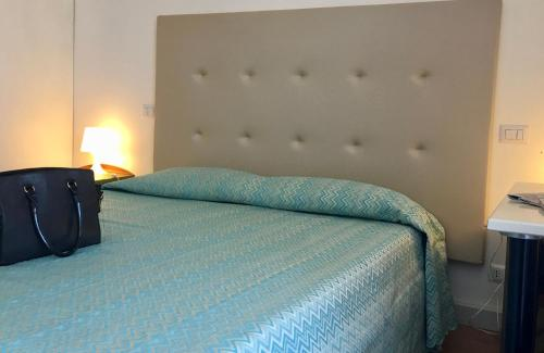 A bed or beds in a room at 38 Aira Hotels