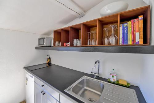 A kitchen or kitchenette at Uzès Townhouse with Loggia & Views