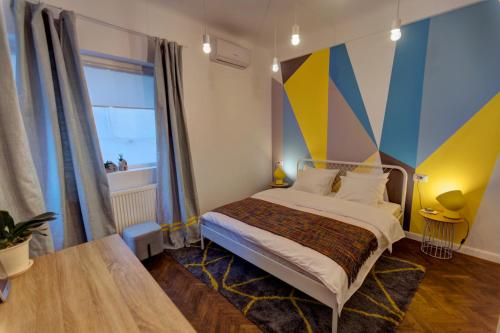A bed or beds in a room at First Hostel Bucharest