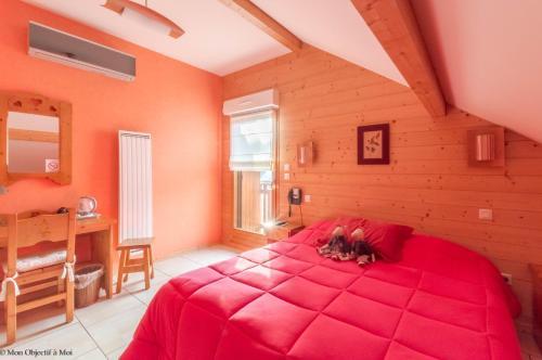 Un ou plusieurs lits dans un hébergement de l'établissement Hôtel la Maison d'Hôte