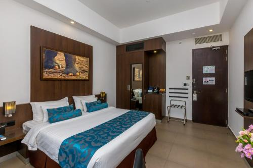 A bed or beds in a room at Best Western Elyon Colombo