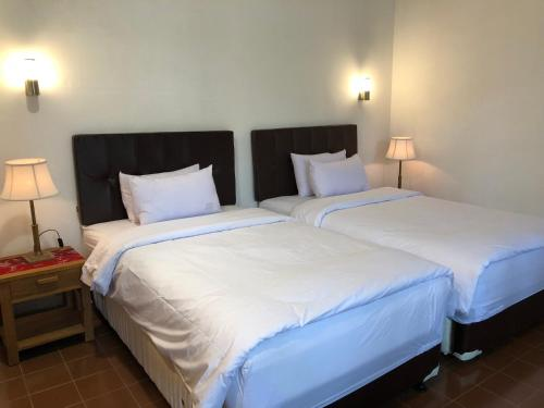 A bed or beds in a room at Rumah Dharma 3 Grha Timoho