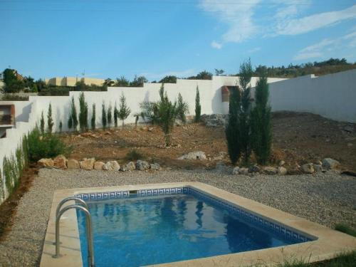 The swimming pool at or near Loma Bella