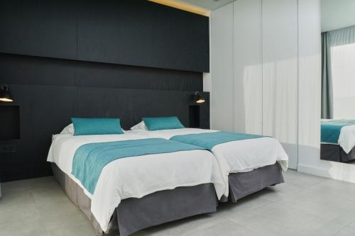 A bed or beds in a room at Club la Santa All sports inclusive