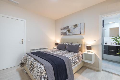 Cama o camas de una habitación en Apartamentos Recogidas