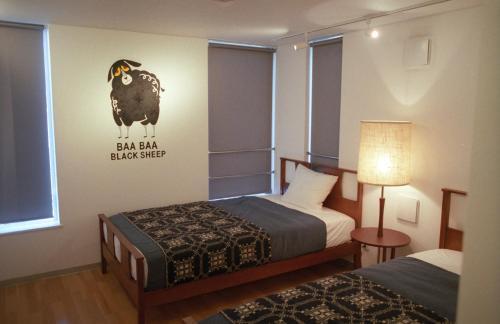 Art Apartment AOCA Sanno SHEEPにあるベッド