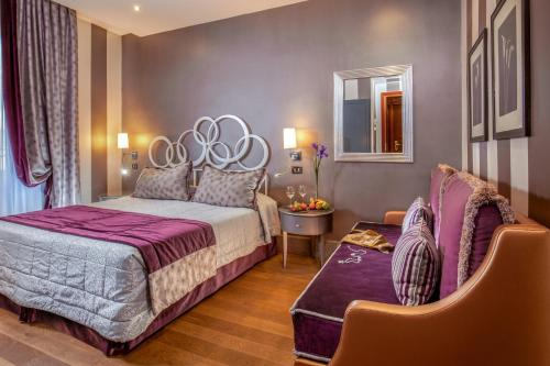 A bed or beds in a room at Hotel Morgana