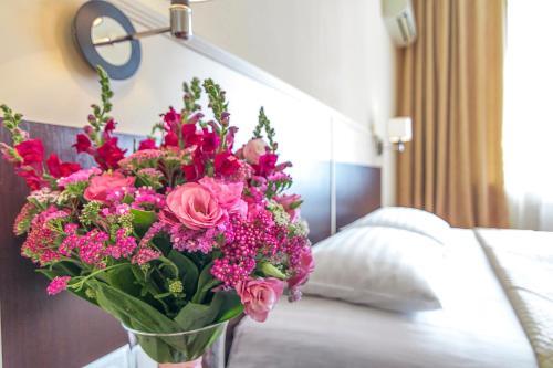 Cama o camas de una habitación en Ukraine Hotel