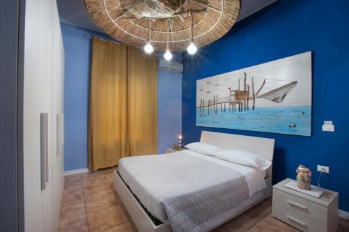 Letto o letti in una camera di Marini Bed&Breakfast