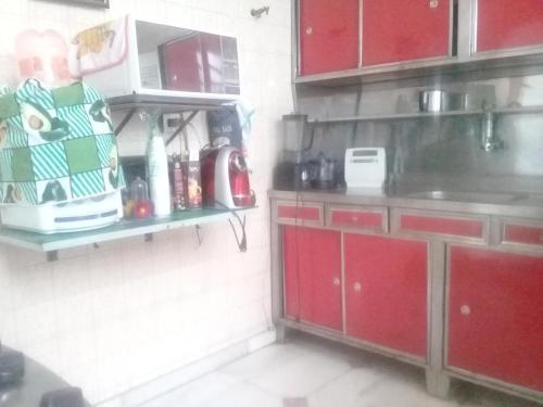 A kitchen or kitchenette at Hostel Residential Inn