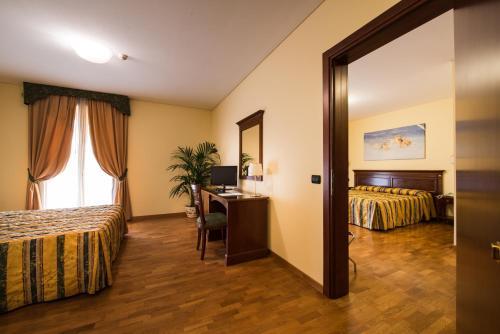 TV o dispositivi per l'intrattenimento presso Hotel Villa Dei Carpini