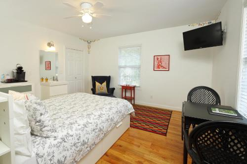 A bed or beds in a room at Swamp Rabbit Inn