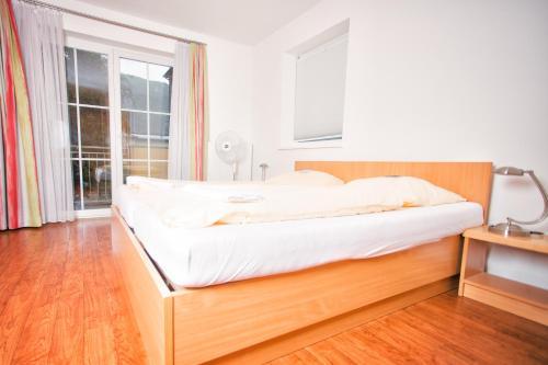 Ein Bett oder Betten in einem Zimmer der Unterkunft YoHo - International Youth Hostel