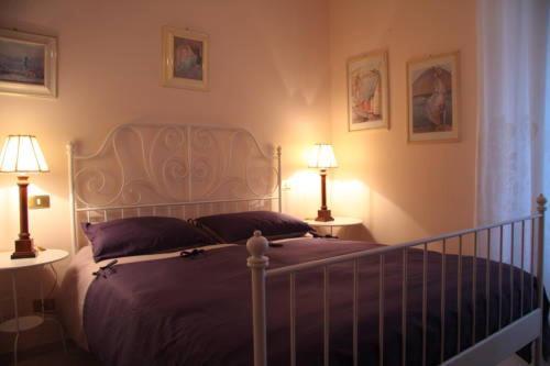 Letto o letti in una camera di Borgo Antico Santa Lucia