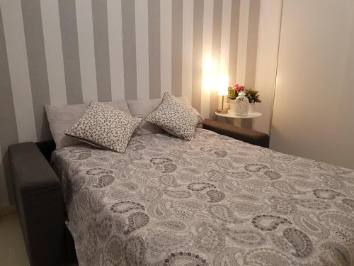 A bed or beds in a room at Luxury brand new studio-monolocale
