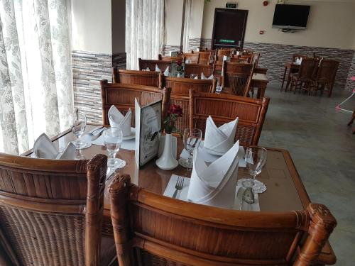 A restaurant or other place to eat at Sahara Hotel
