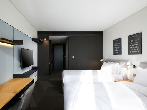 A bed or beds in a room at GLAD Mapo