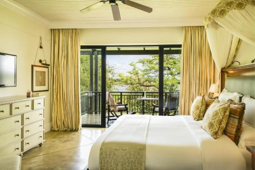 A bed or beds in a room at Royal Livingstone Hotel by Anantara