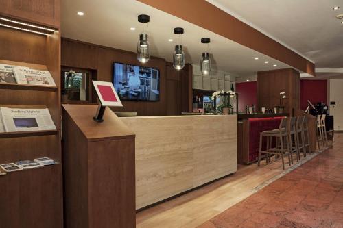 Lobby/Rezeption in der Unterkunft H+ Hotel Nürnberg