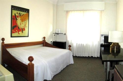 Letto o letti in una camera di Residence Domus