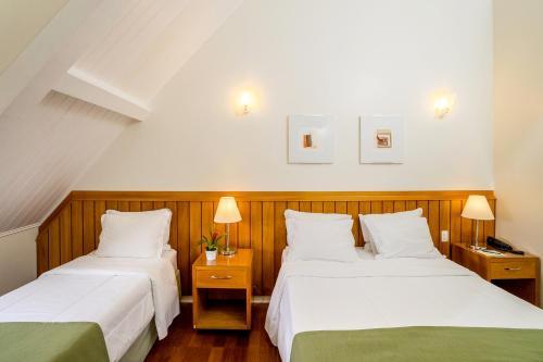 Cama ou camas em um quarto em Vila Verde Hotel Atibaia