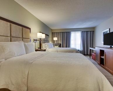 A bed or beds in a room at Hampton Inn Warner Robins
