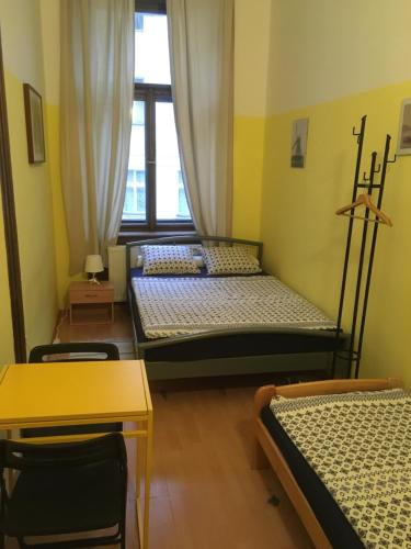 A bed or beds in a room at Hostel EMMA
