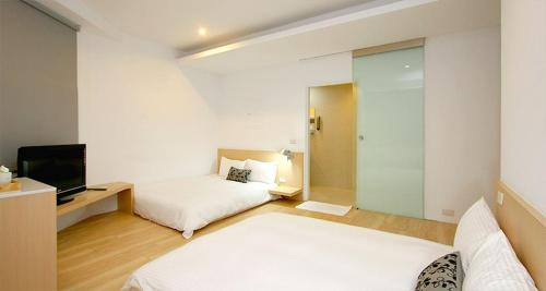 A bed or beds in a room at Ke Ting