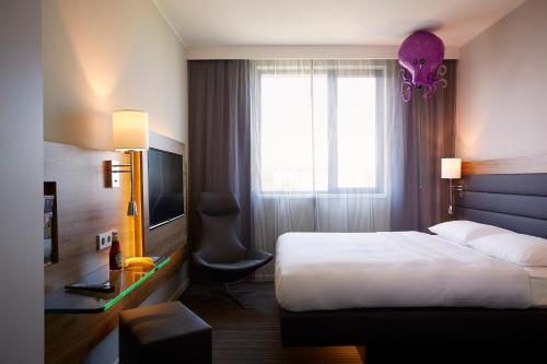 A bed or beds in a room at Moxy Milan Linate