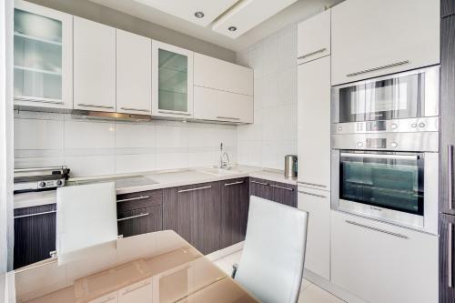 Кухня или мини-кухня в Апартаменты Рай