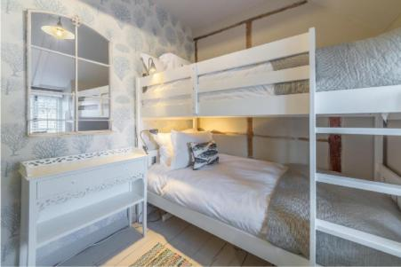A bunk bed or bunk beds in a room at No33 Thornham Cottage 3